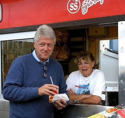 Hillary Pushing for Bill to Decrease Emissions...A defiant Clinton seen here sneaking a chili dog