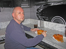 Bald Tony enjoys a secret slice