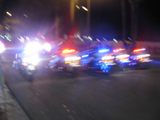 It looks like it might be a line of motorcycle cops, but it's kind of blurry
